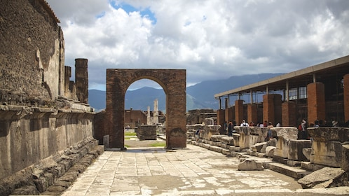 View of Pompeii ruins during cloudy day.