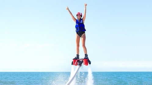 Young woman on a flyboard over the water in San Jose