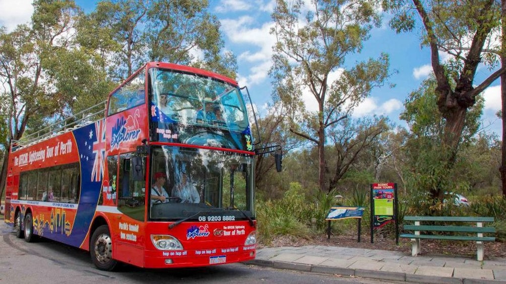 Show item 3 of 8. Hop-on hop-off bus at a park in Perth