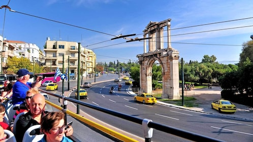 taking pictures from the top deck of a blue bus in Athens