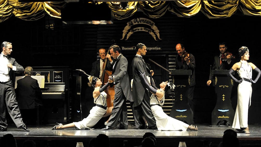 couples performing tango on stage with live music in Argentina