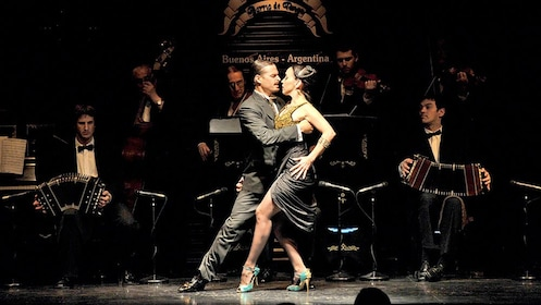 man and woman dancing on stage with live music in Argentina