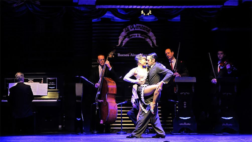 dancers performing tango on stage with live music in Argentina