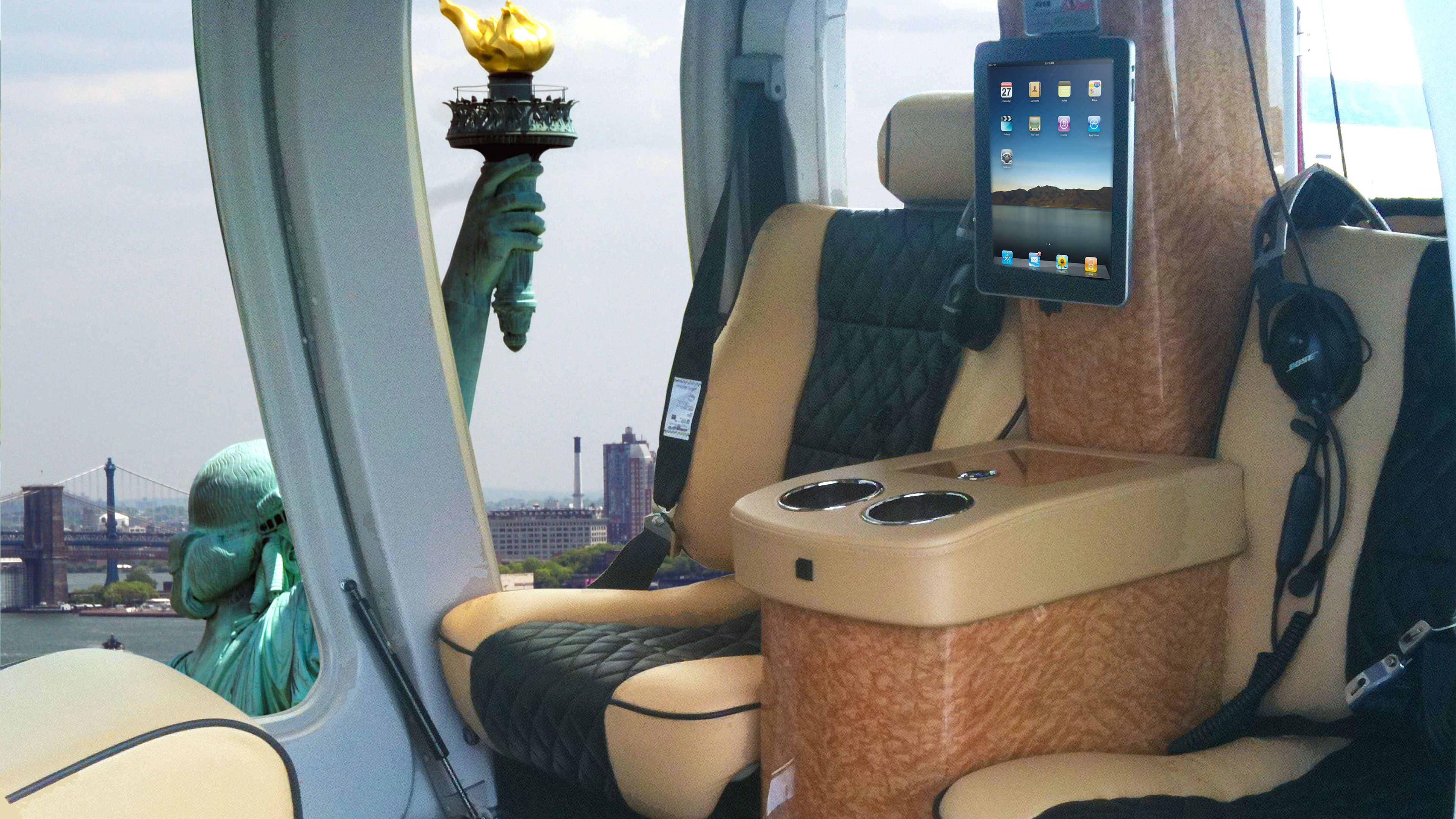 Interior view of helicopter with Statue of Liberty seen by window.