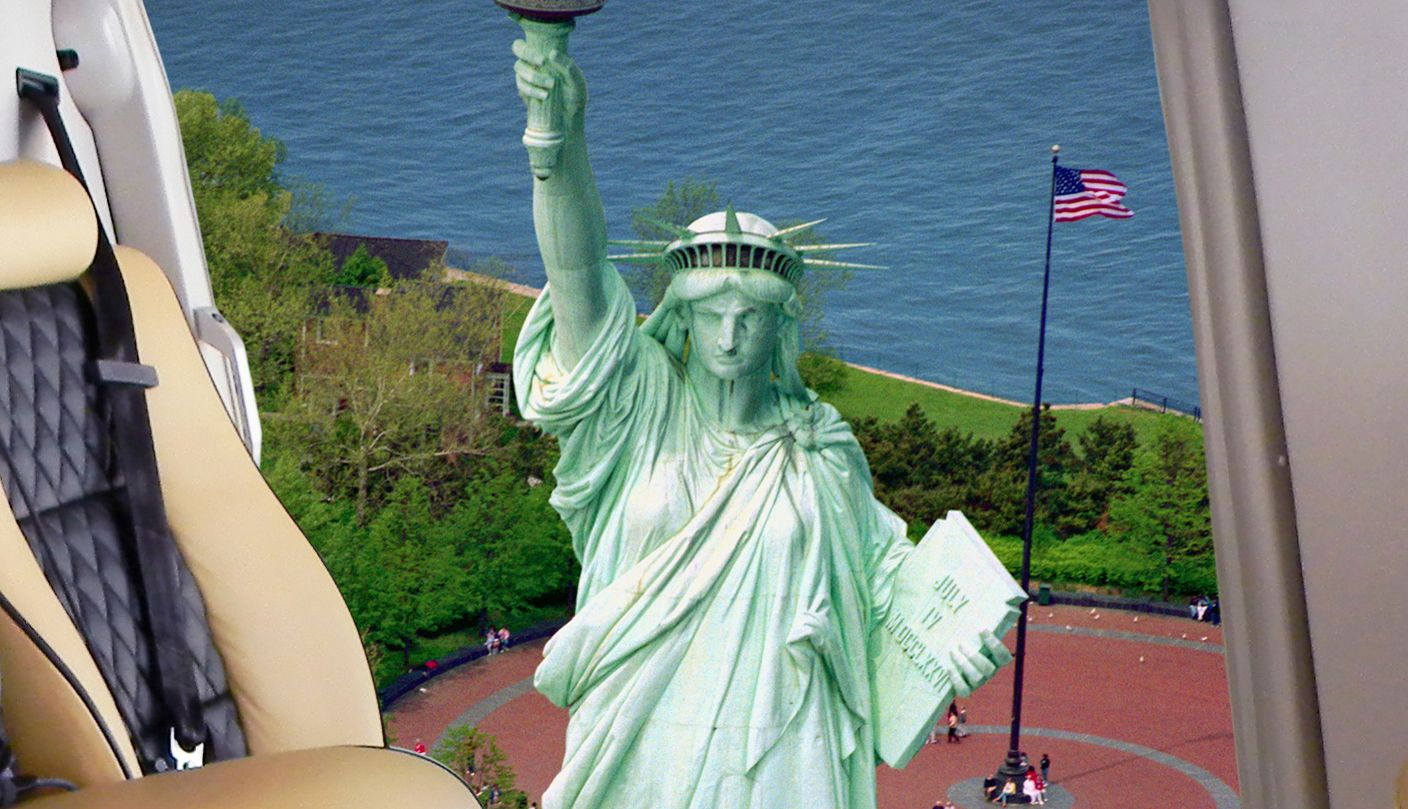 View of statue of liberty from inside helicopter.
