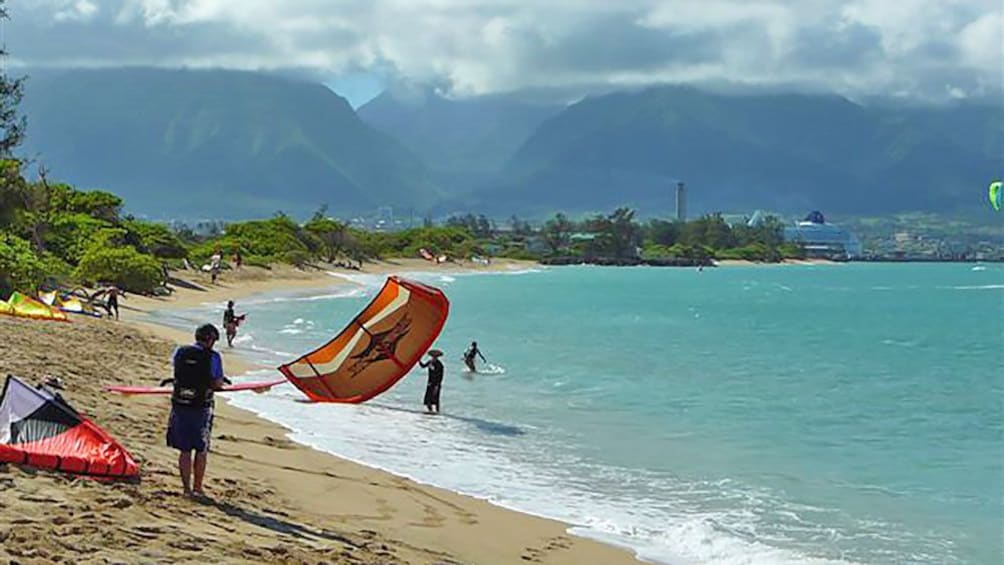 Show item 8 of 8. kiteboarders at the beach in Maui
