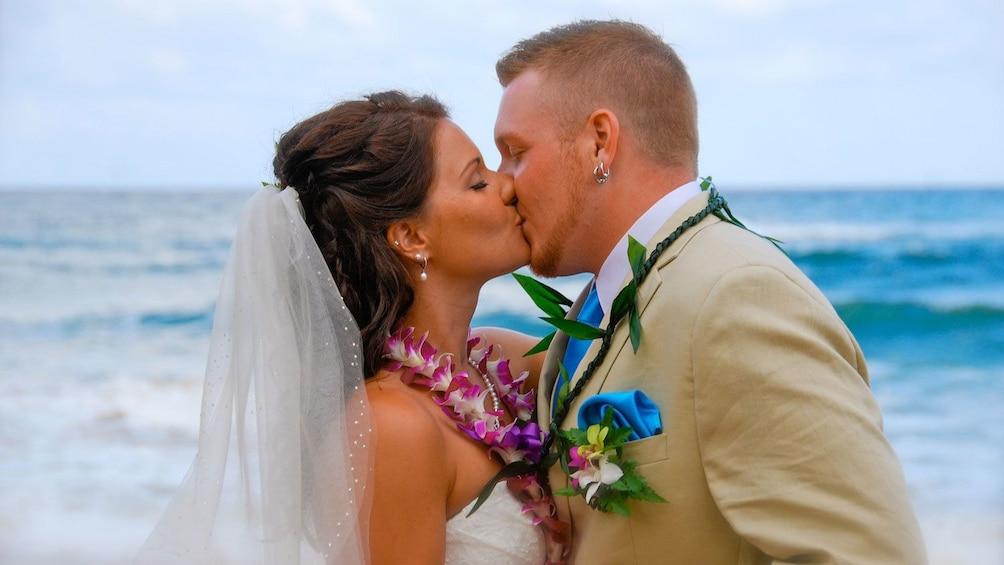 Show item 2 of 5. Wedding couple on the beach in Kauai