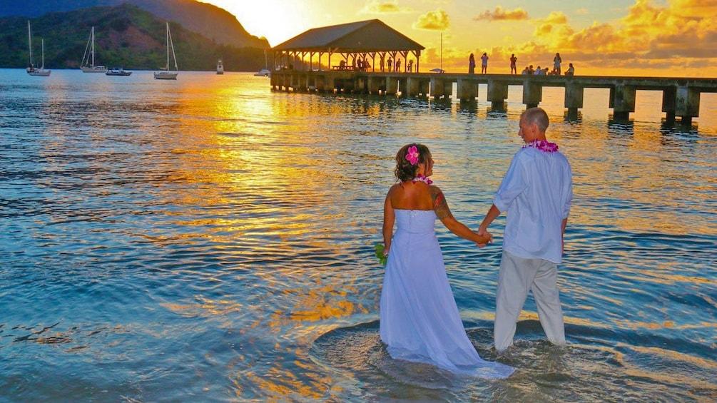 Show item 5 of 5. Wedding couple on the beach in Kauai