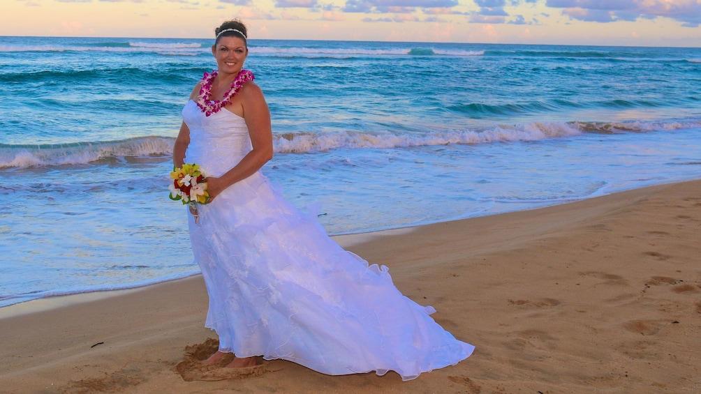 Show item 3 of 5. Bride on the beach in Kauai