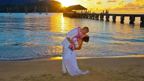 Man and woman kissing at sunset in Kauai