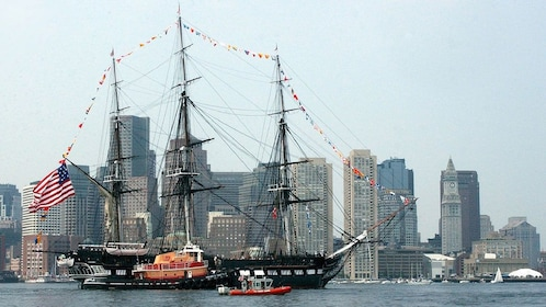 a large wooden ship with hanging flags in Boston