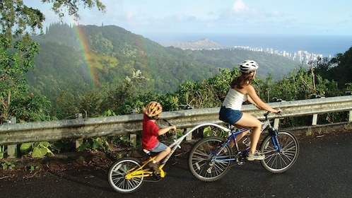 Mother and child bicycling in the hills on Oahu
