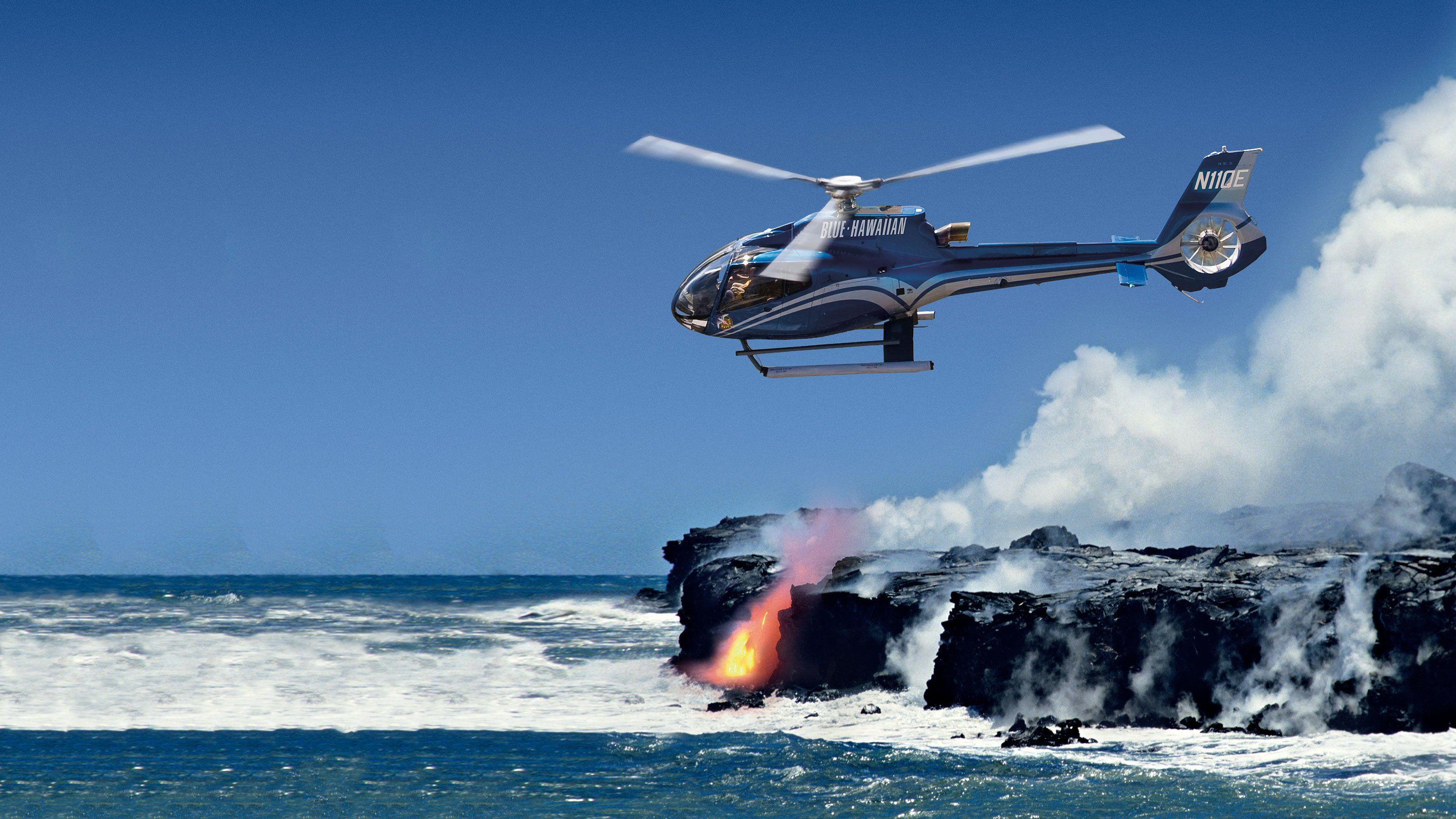 Volcano flying over lava entering the ocean in Hawaii