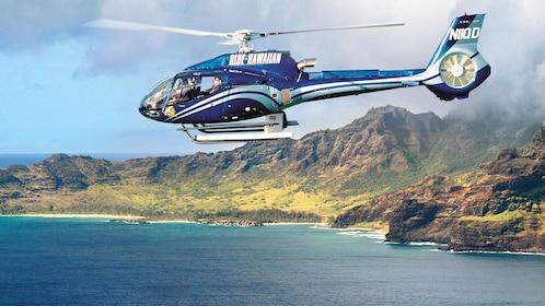 helicopter flying over ocean shores in Kauai