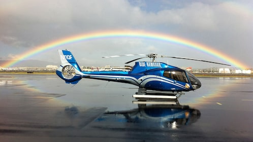 Helicopter under a rainbow at the airport
