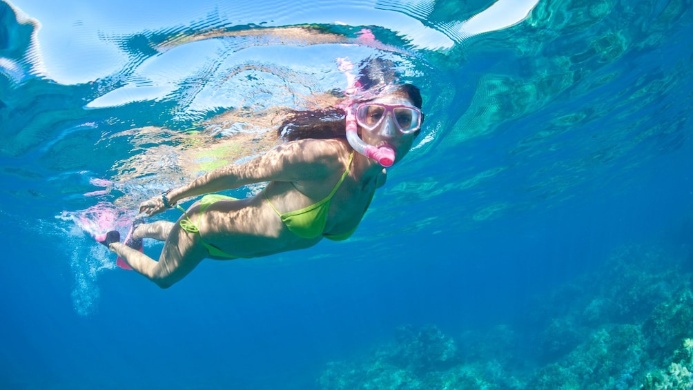 Show item 4 of 8. Woman snorkeling underwater in off the Molokini coast