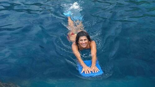 Woman swimming in Hawaii