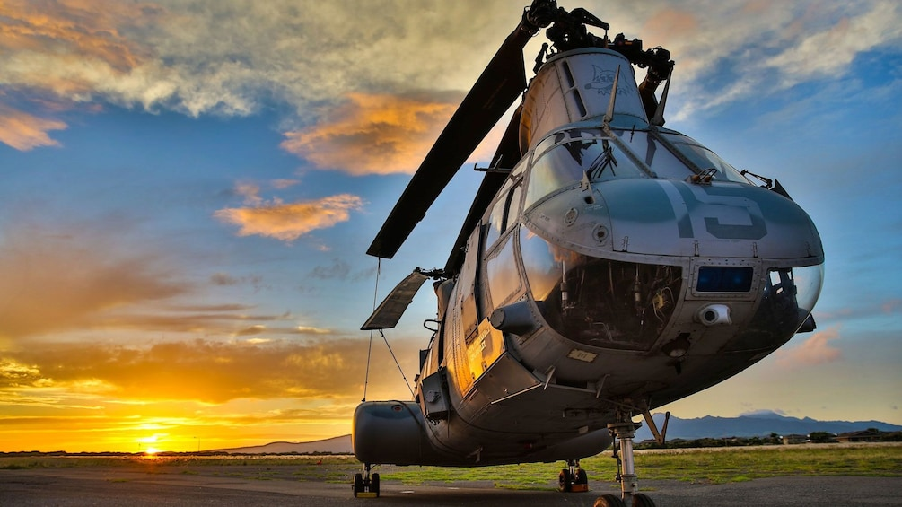 Helicopter stationed at the Pacific Aviation Museum during sunset