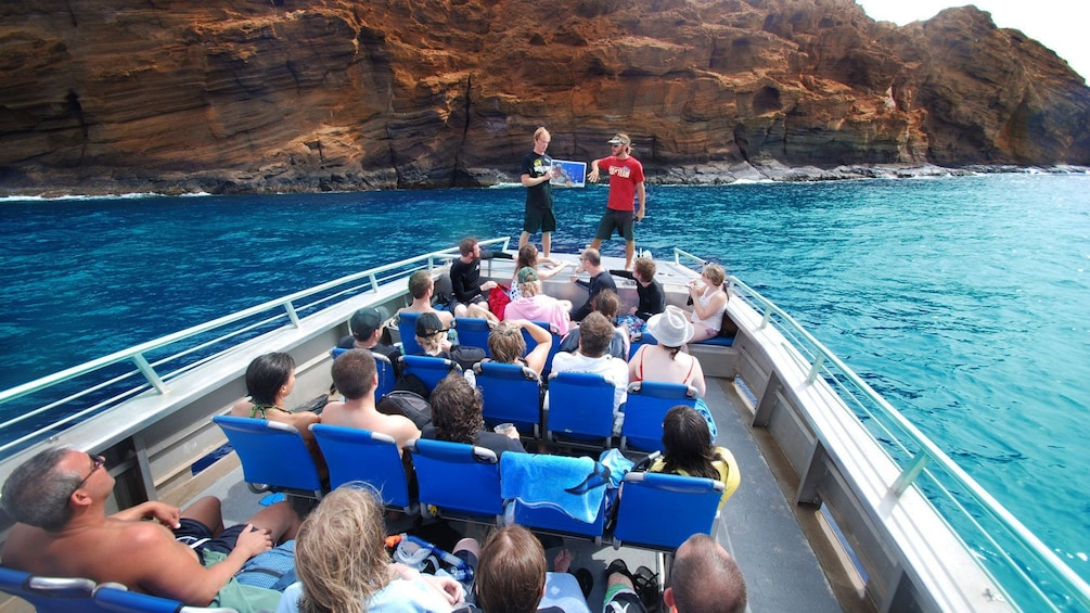 Show item 4 of 8. Tour guides giving presentation to audience on the Molokini Wild Side Eco Adventure in Maui