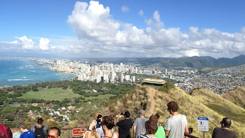 Arrive at the summit of Diamond Head Crater overlooking Honolulu