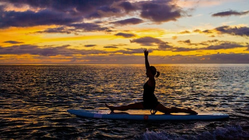 Yoga pose on paddle board in Oahu