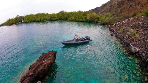 Kayakers swimming in the coral reef in Hawaii