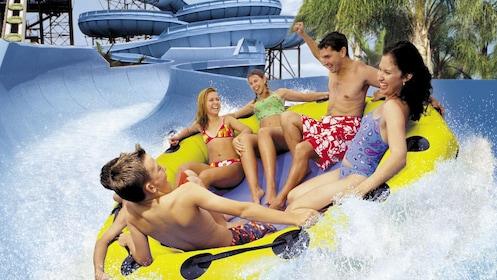 Friends in large inner tube on waterslide in Oahu