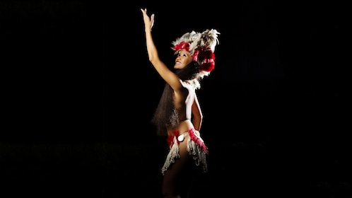 Woman performer in spotlight for the Drums of the Pacific Luau in Maui