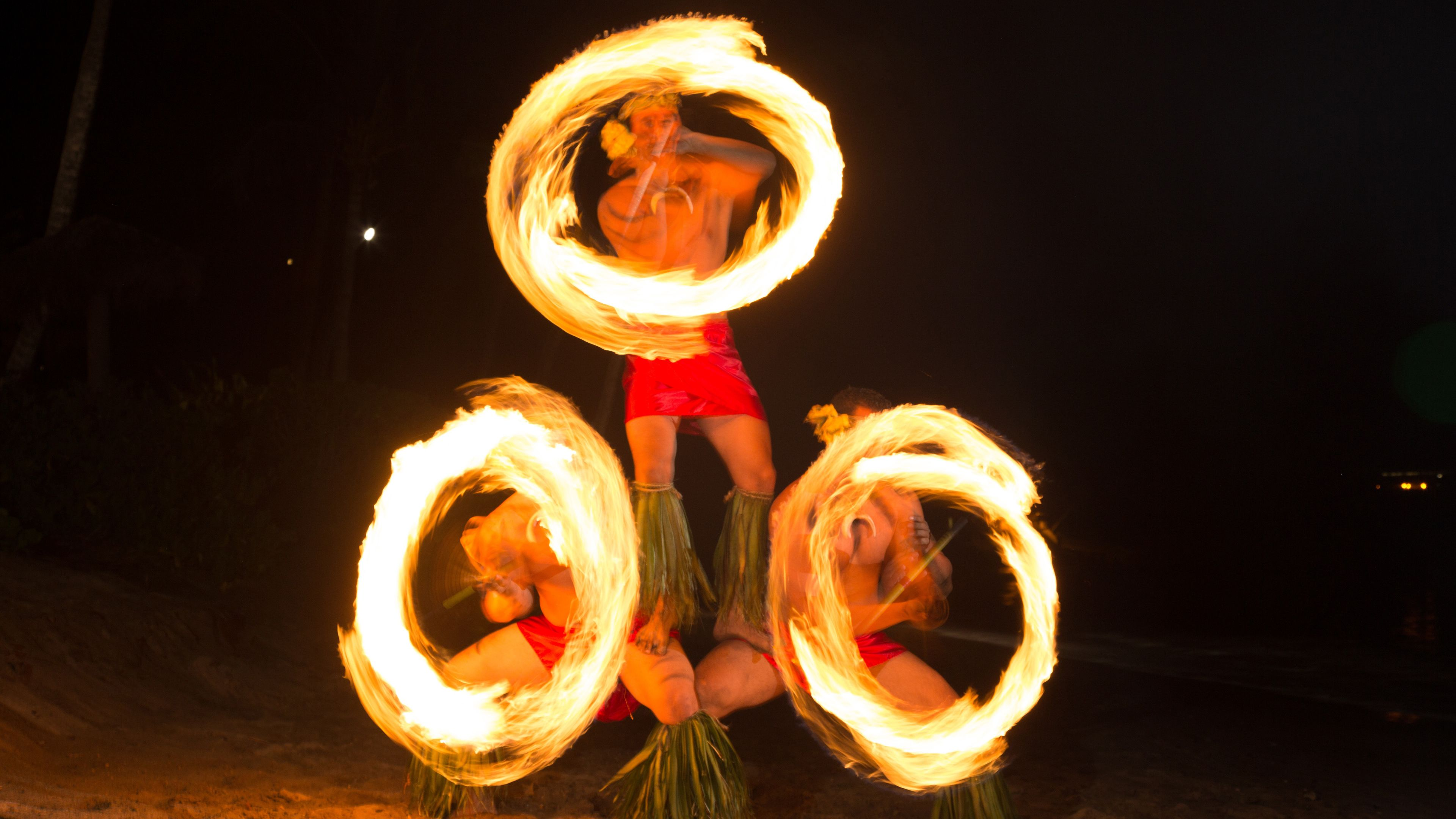 Trio of fire twirlers at Drums of the Pacific Luau