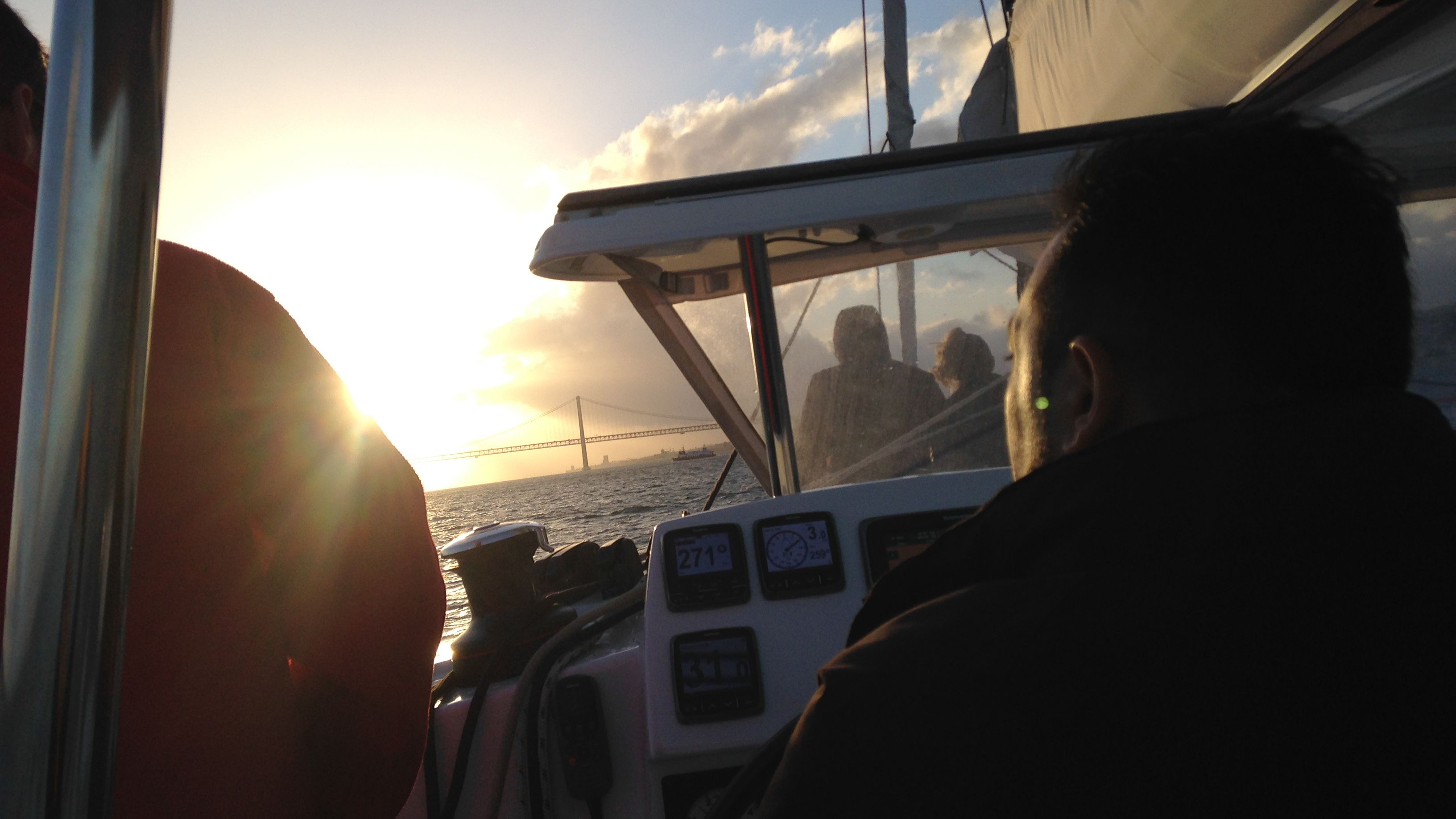 Passengers on boat observing the sunrise.