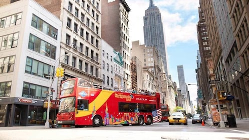 a double decker bus navigating the city of New York
