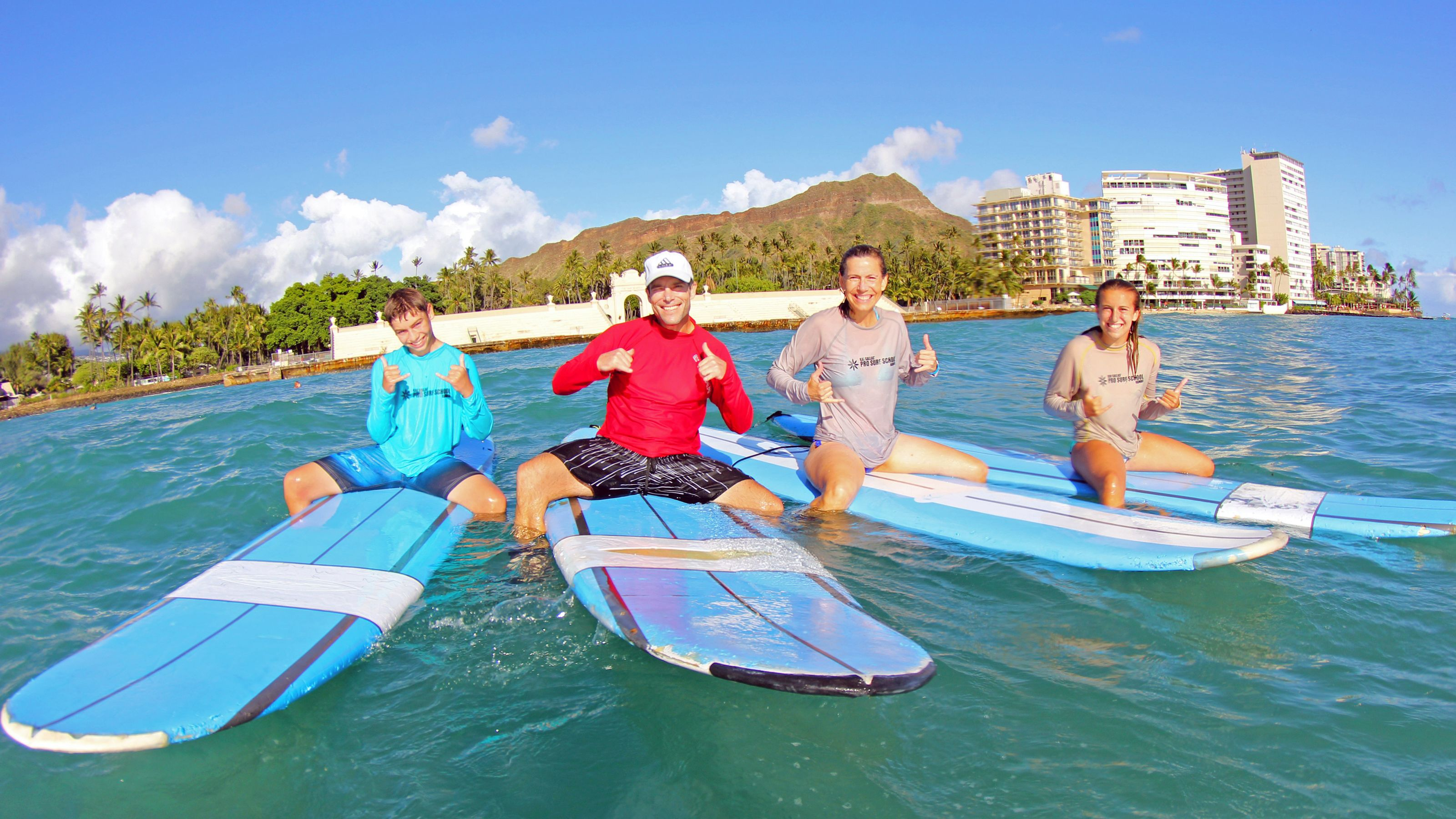 Family on surf boards in Oahu