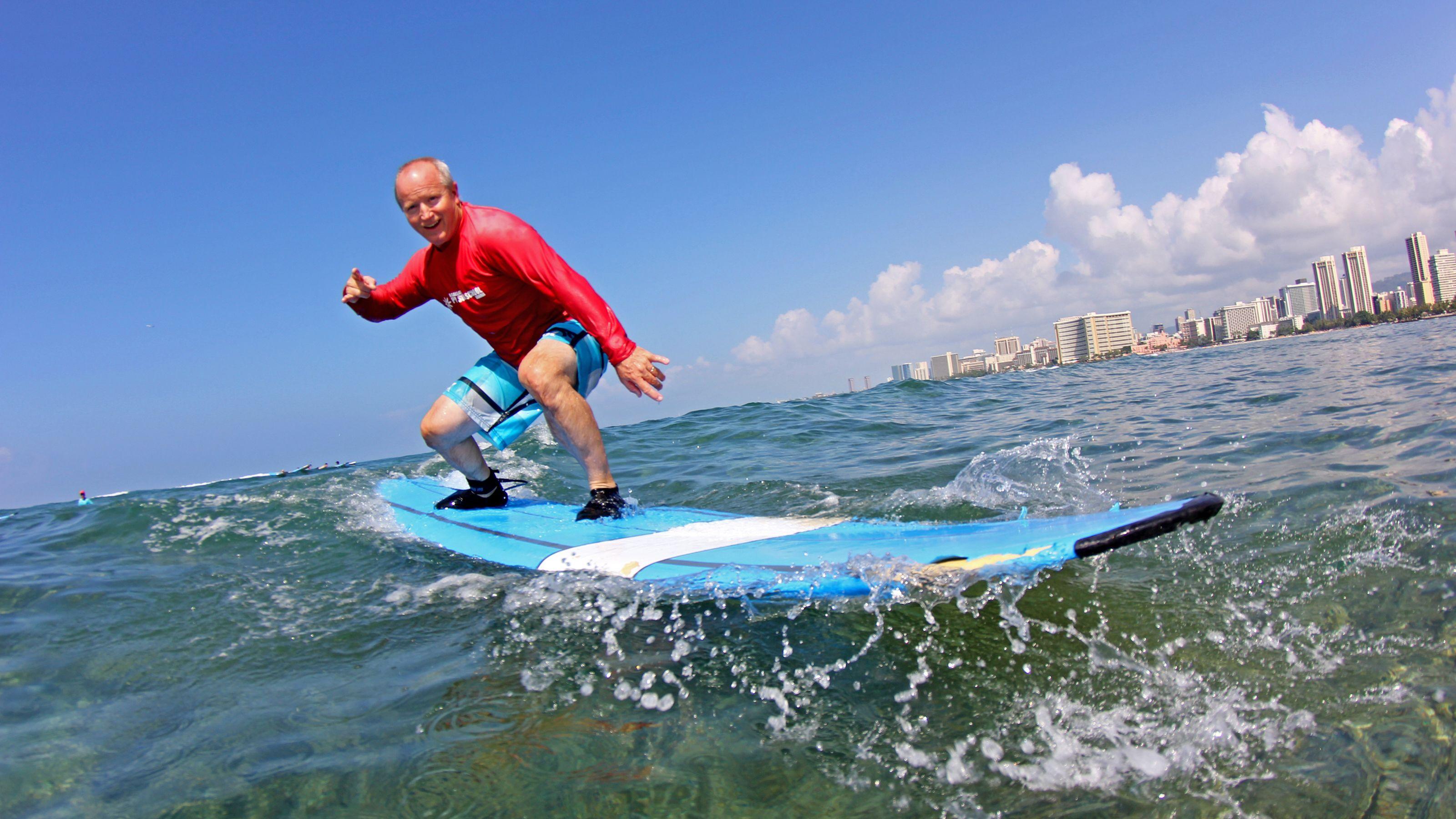 Man on surf board in Oahu