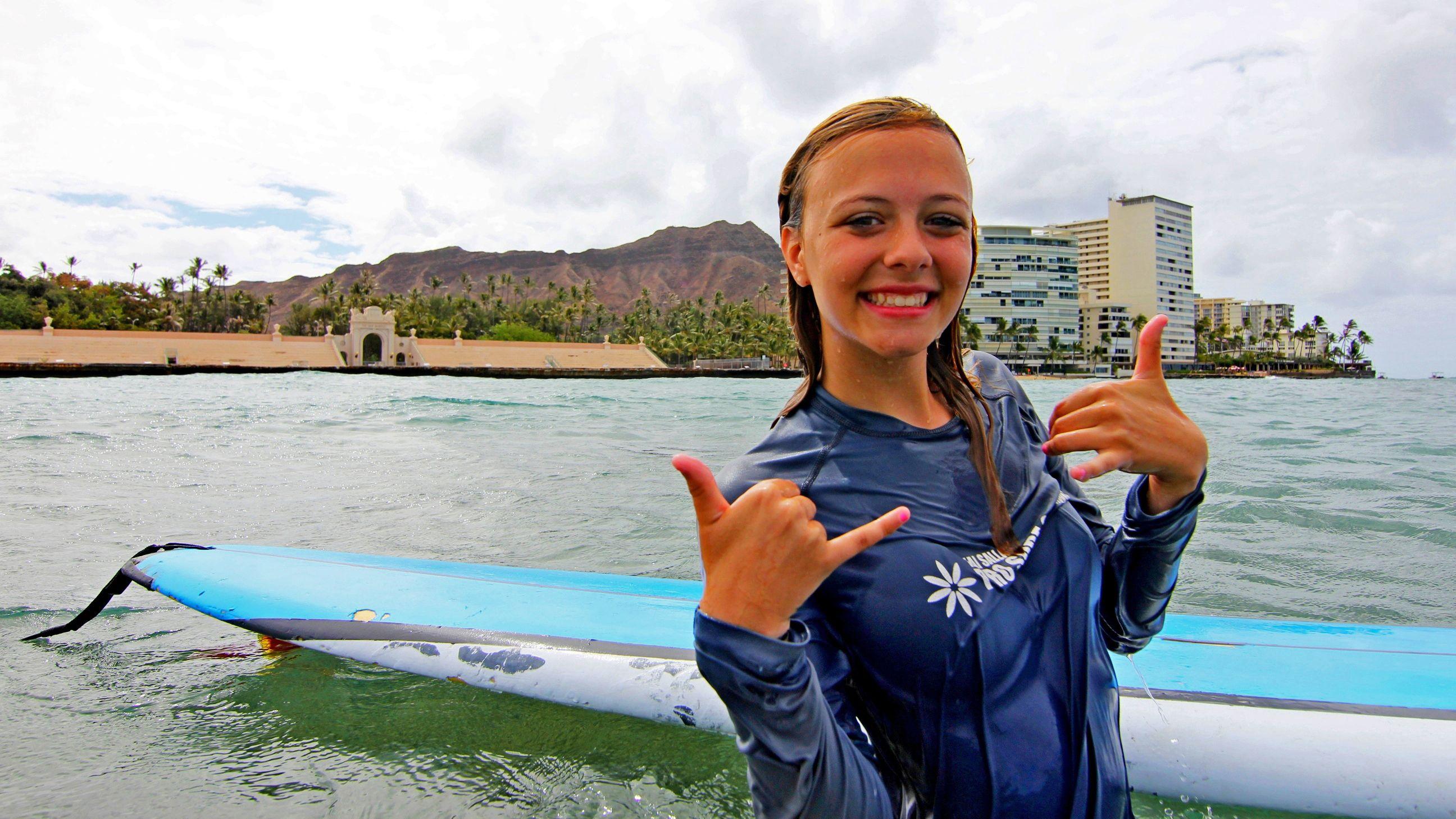 Girl on surf board in Oahu