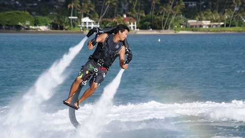 Adventurer in H2O Jet Pack hovering above the water in Oahu