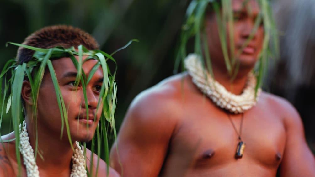 Show item 3 of 5. two male Hawaiian dancers at luau in Kauai