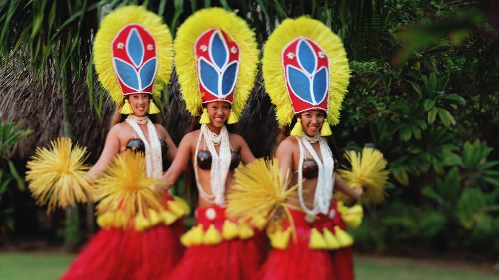 Show item 1 of 5. three Hula dancers at luau in Kauai