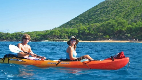 couple kayaking near the beach in Maui