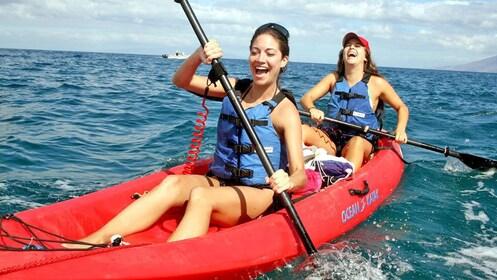 women having a blast while kayaking in Maui