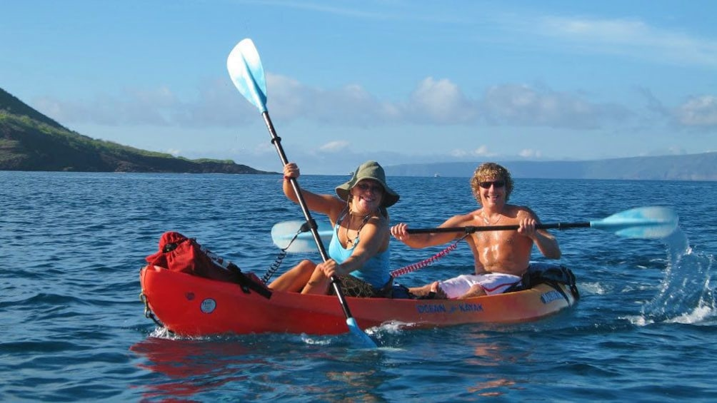 Show item 3 of 10. People in tandem kayak in Maui