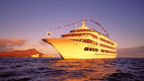 Sail on the Star of Honolulu to experience the scenic views of the ocean at sunset