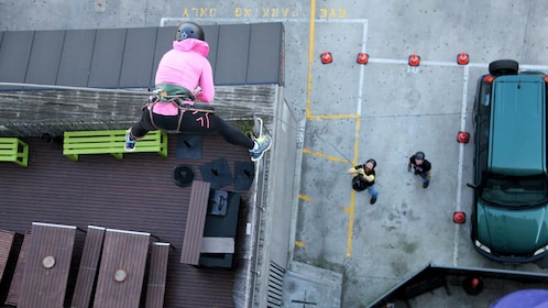 Woman abseiling down building in Melbourne
