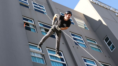 Man abseiling down building in Melbourne
