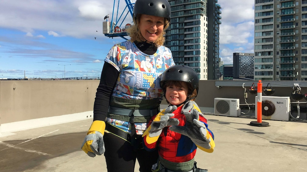 Show item 5 of 5. Woman and young girl excited to abseil down building in Melbourne