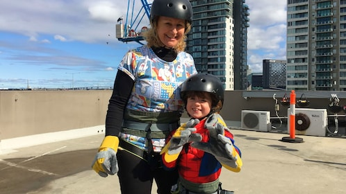 Woman and young girl excited to abseil down building in Melbourne