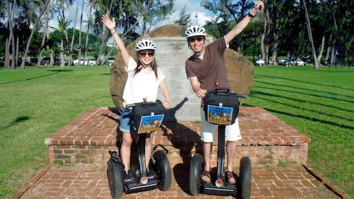 Couple posing for a photo op while touring Honolulu on segway