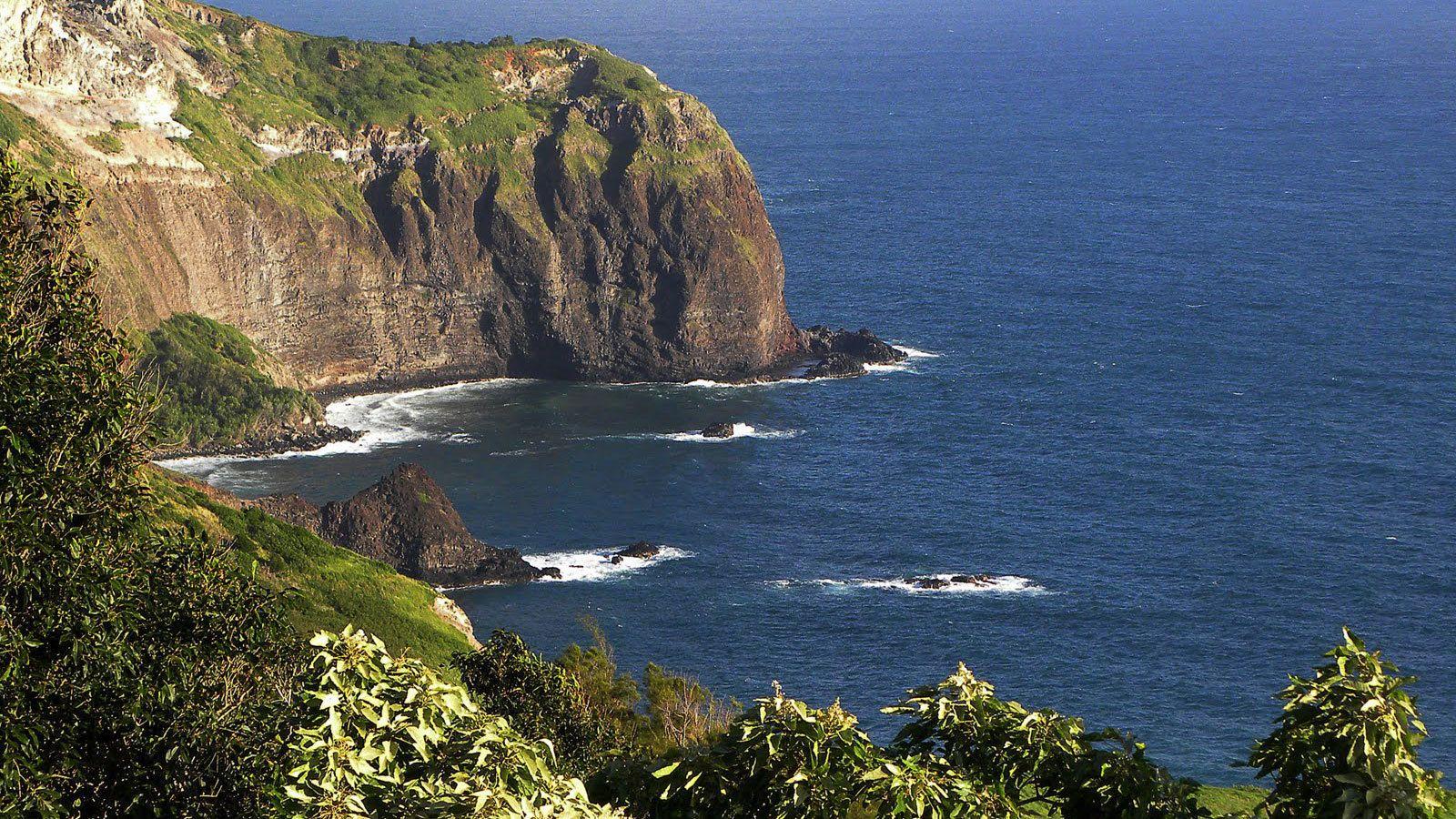 Rocks in ocean near the shore line in Maui