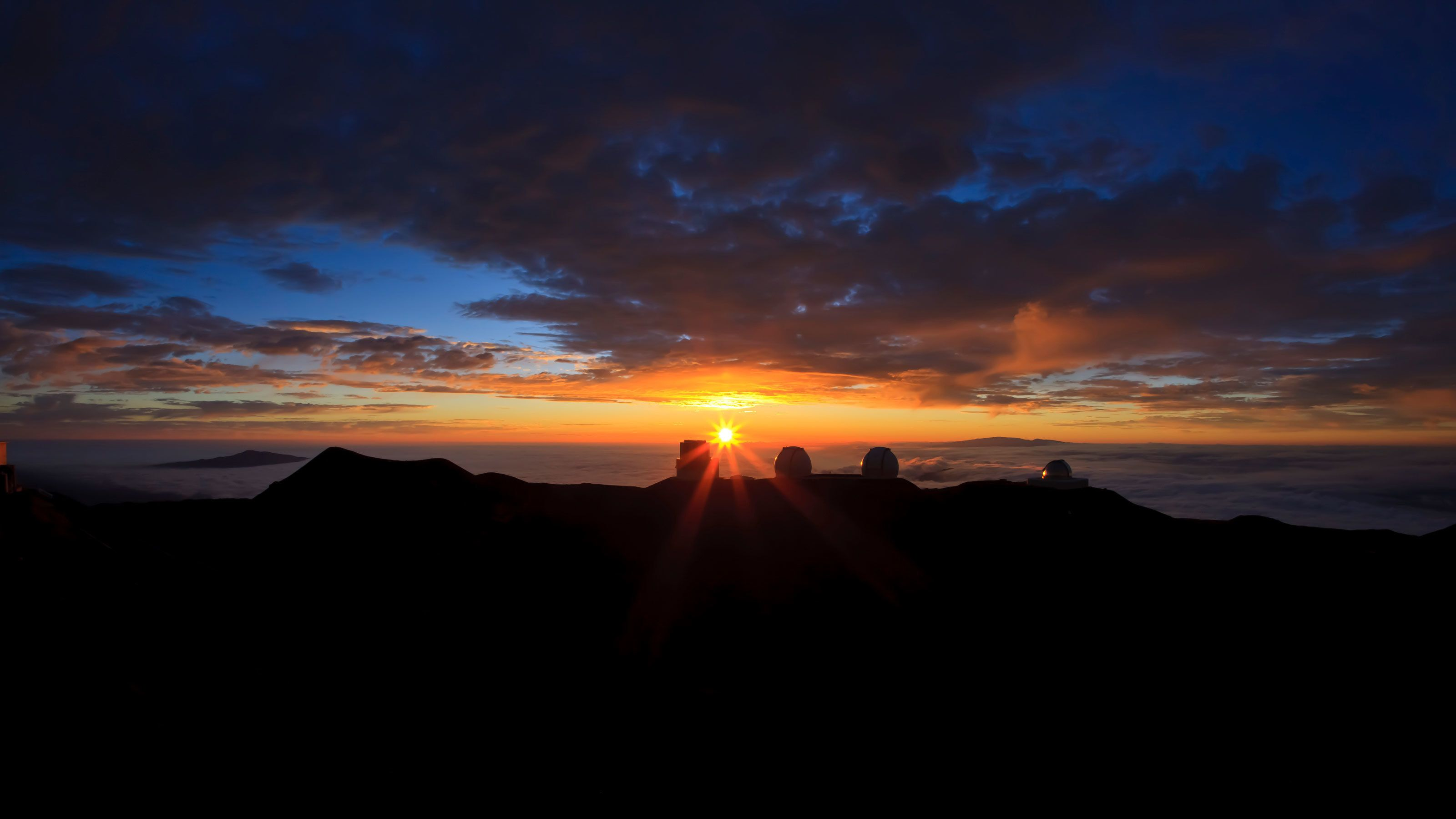 silhouettes of the? Mauna Kea Space Observatories in sunset in Hawaii