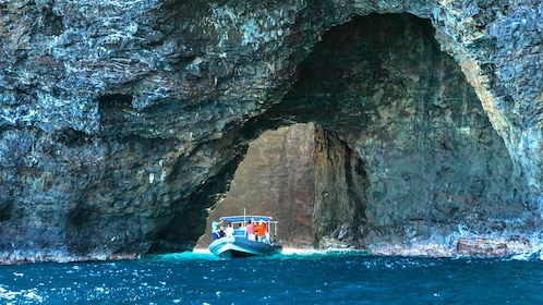Cruise boat along the coast in a cave of Hawaii