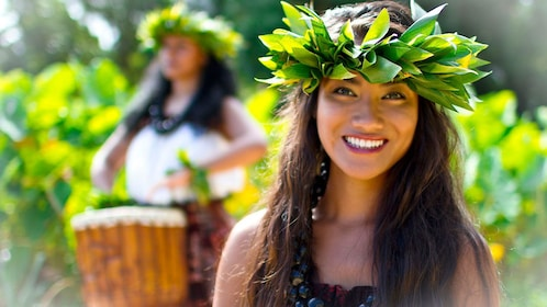 Female luau performer with a leaf crown on in Hawaii
